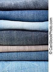 calças brim azuis, pilha, fundo