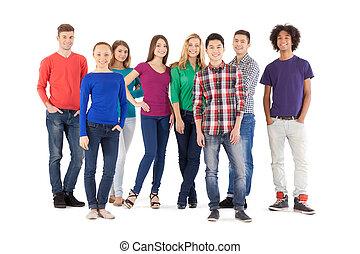 ficar, cheio, pessoas, pessoas., isolado, jovem, alegre, enquanto, câmera, casual, comprimento, branca, sorrindo