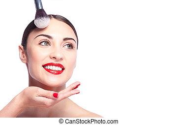 mulher bonita, aplicando, jovem, rosto, cosméticos