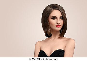 mulher bonita, jovem, elegante, posar, estúdio