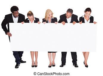 painél publicitário, grupo, businesspeople, segurando