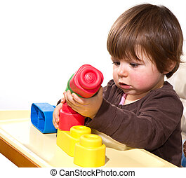 pequeno, blocos, menina, coloridos, tocando
