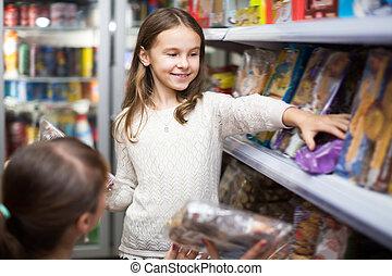 pequeno, comprando, menina mulher, doces