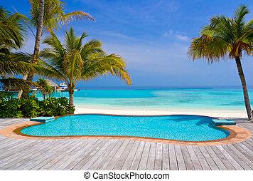 praia tropical, piscina